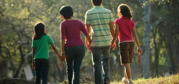 Family walking through the park